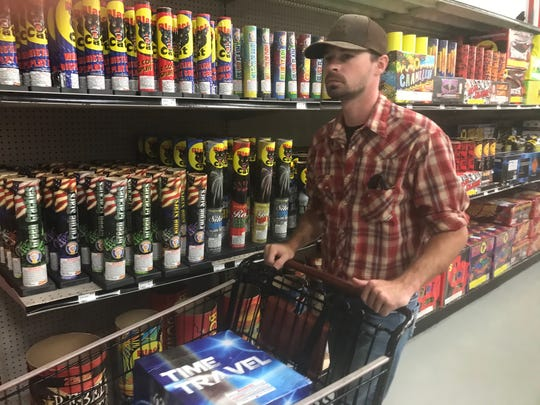 Pomeroy resident Cody Weaver stocks up of fireworks at Hamburg Fireworks & Jerry's Fireworks Factory in preparation for the Fourth of July. The ongoing coronavirus pandemic has forced the cancellation of some public fireworks displays. The city's fireworks show is canceled, but Hamburg owner Ken Sprague said his company will present a three- to five-minute mini display from Mount Pleasant on July 4. There will be no public viewing areas however.