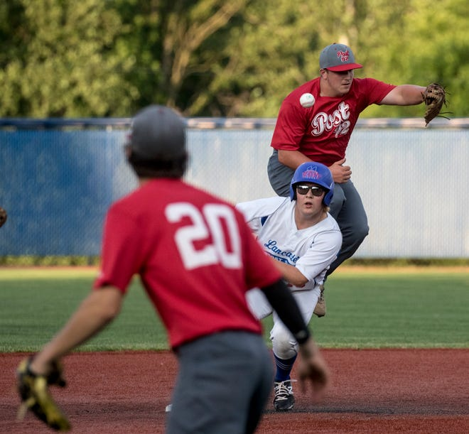 Garrett Meyers of Utica Post 92 misses the ball letting Brody Poston of Lancaster Post 11 make it safely to 2nd. Lancaster Post 11 hosted Utica Post 92 at Beaver field Tuesday night.