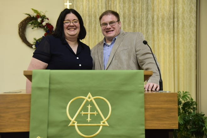 The Revs. Heather Runser McLeod and Sean McLeod stand behind Heather's pulpit at Christ United Methodist Church in Galion. Sean leads the congregation at Woodlawn United Methodist Church in Bucyrus.