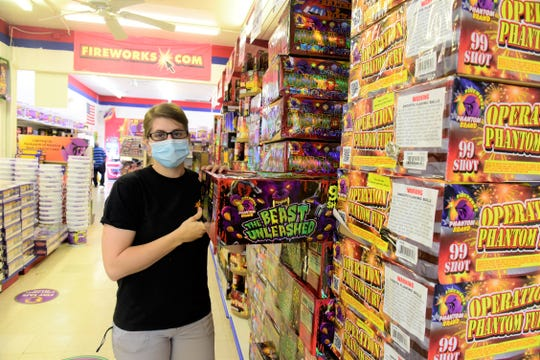 Abbey Mahon, assistant manager at Phantom Fireworks of Mansfield, shows off some of the more popular items the store has to offer.