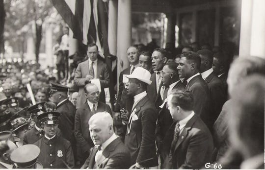 A delegation from a black Baptist convention visits Marion, Ohio, and the home of Warren G. Harding to show its support for his 1920 presidential campaign. In office, Harding repeatedly addressed racial issues.