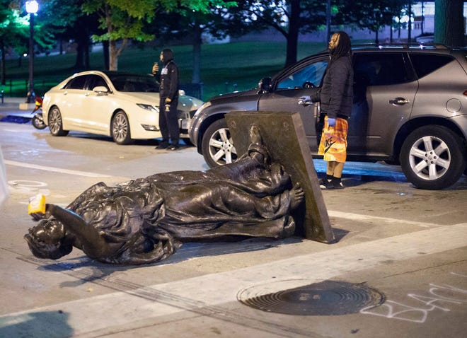 "Wisconsin's ""Forward"" statue lies in the street on Capitol Square in Madison, Wis. Tuesday, June 23, 2020.  Crowds outside the Wisconsin State Capitol tore down two statues and attacked a state senator amid protests following the arrest of a Black man who shouted at restaurant customers through a megaphone while carrying a baseball bat."