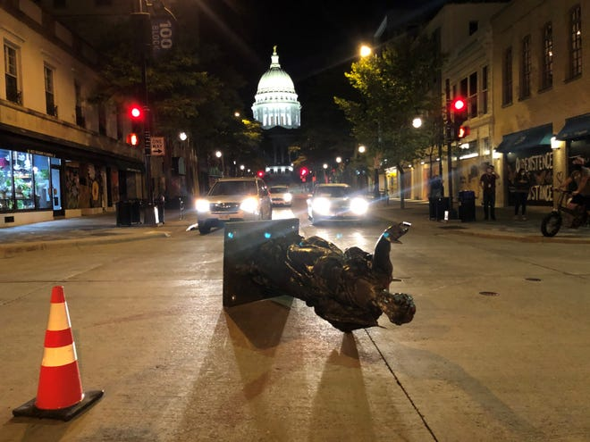 """The """"Forward"""" statue that typically sits at the top of State Street outside of the Wisconsin State Capitol was torn down Tuesday by protesters."""