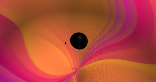 """This illustration is a face-on """"snapshot"""" from a numerical relativity simulation of the two bodies moments before merger. There is a nine-fold difference between the two objects' masses."""