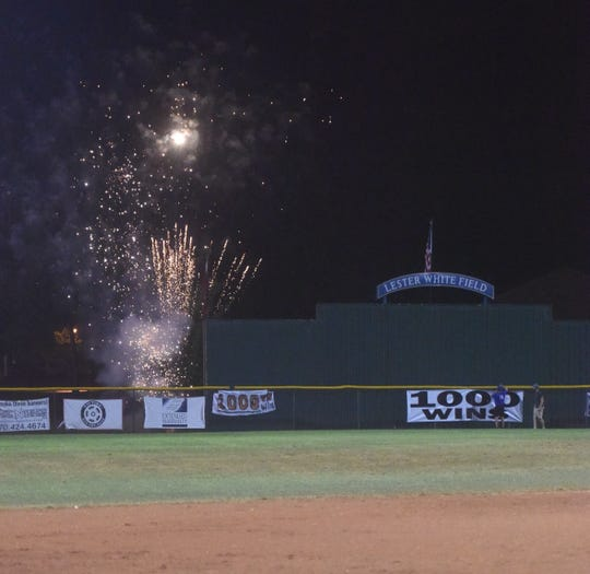Fireworks are set off beyond the center field fence after Lockeroom coach Lester White reached his 1,000th victory last weekend.