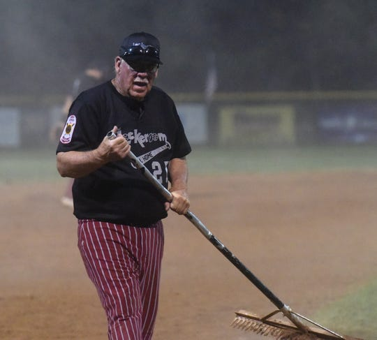 Lockeroom head coach Lester White rakes the infield during a recent game.