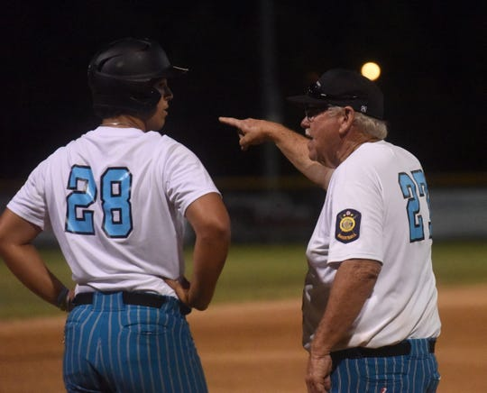 Lockeroom head coach Lester White instructs Dawson Tabor during a recent game.