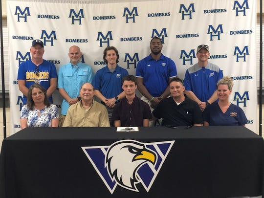 Tyler Sosnowski signed Wednesday to run cross country and track at Williams Baptist University in Walnut Ridge. Pictured at Wednesday's signing ceremony are (front row, from left) Robin Sosnowski, Walter Sosnowski, Tyler Sosnowski, Stephen Sosnowski, Genette Wise; (back row) MHHS cross country coach Clint Pevril, MHHS cross country coach Robert Blades, Williams Baptist assistant coach John Fairris, Williams Baptist head coach Tim Shepard, and MHHS track and field coach Philip Goodwin.