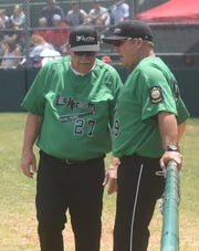 Lockeroom coach Lester White talks with assistant coach Marty Ninemire during a recent game.