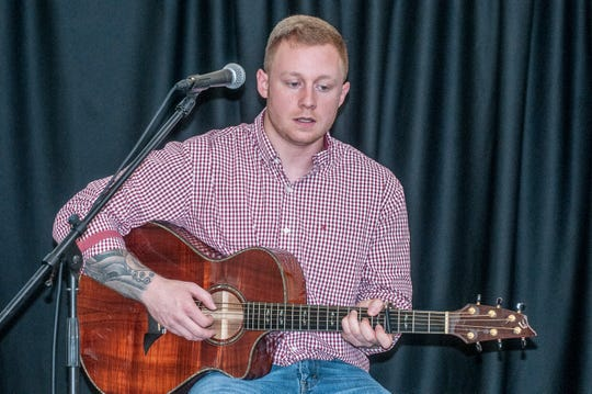 Colby Register performs one of his original songs at The Sanctuary in Montgomery during an artist spotlight hosted by the Montgomery Area Musicians Association.