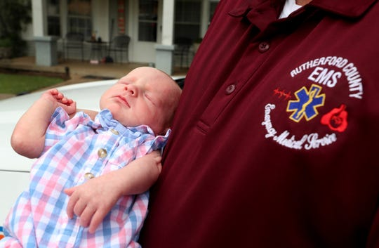 EMT Carl Hudgens holds Easton Johnson, the 2 week-old son of Jeremy Johnson, on Wednesday, June 24, 2020. Hudgens saved Jeremy Johnson's life after a car wreck 20 years ago. After the wreck the two men have remained friends.