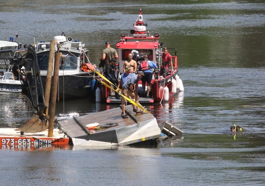 Divers removed a body from Lake Hopatcong after a weed harvester flipped over while clearing a shallow section of the lake on Wednesday, June 24, 2020.