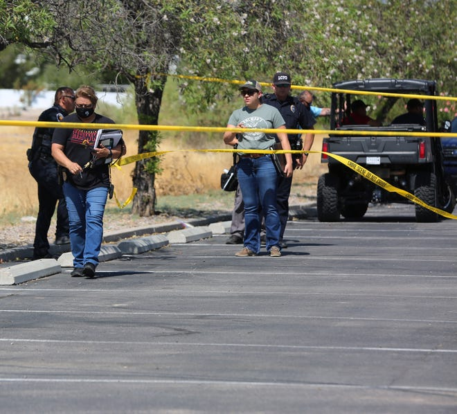Police investigate a shooting at the Casa Bandera Apartments, located at 855 E. University Ave., on Wednesday, June 24, 2020.