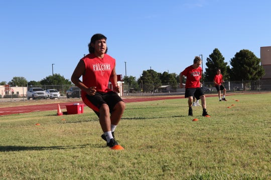 Loving Falcons work in a group of five athletes through cardio training in his 7:30 a.m. pod at George Frederick Field in Loving, New Mexico June 24.