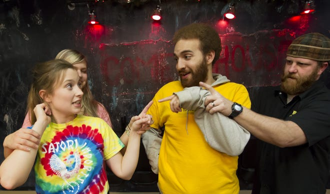 The Backlot Comedy House performers act out a game of freeze during a practice session with Katie Kildahl and Brad Crook in this 2013 file photo.