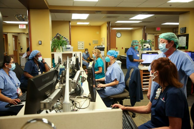 Nurses use computers at a work station in the COVID-19 unit at Eisenhower Health on Wednesday, June 24, 2020 in Rancho Mirage, Calif.