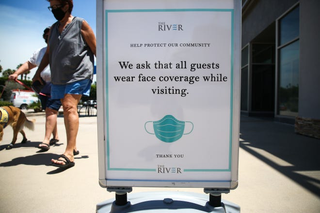 A sign the use of masks as a COVID-19 safety guideline at The River in Rancho Mirage, Calif. on Wednesday, July 24, 2020.