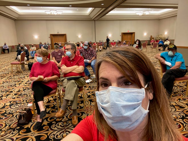 Jennifer Bloomberg of Waddell takes a selfie showing many in red shirts at the June 23, 2020 Glendale City Council meeting to oppose a planned Love's Travel Stop.