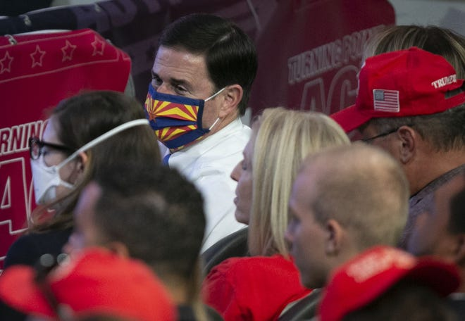 """Arizona Gov. Doug Ducey (top center) looks on as President Donald Trump speaks at the """"Students for Trump"""" rally at Dream City Church in Phoenix on June 23, 2020."""