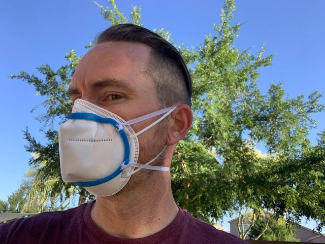 SRP employee Chad Barrett wears one of the 3D printed masks the company developed to address a shortage of safety equipment for utility workers.
