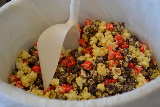 """While Great Lakes Popcorn Co.'s well-known red and white storefront is easy to spot, both new and regular visitors to downtown Port Clinton are also likely to smell one of its many delectable flavors of the self-proclaimed """"world's best popcorn"""" from a block or more away."""