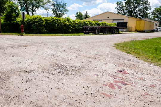 Blood stains are present on the road near 25th and Dixon streets, where police said a man was stabbed multiple times Wednesday morning, June 24, 2020, in Port Huron Township.