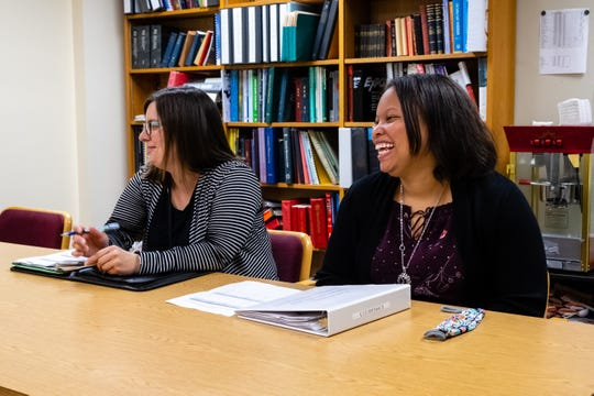 Katy Posey, community development program administrator for the city of Port Huron, left, and Community Development Program Specialist Joi Price laugh during an interview Tuesday, June 23, 2020, in the Municipal Office Center in Port Huron.