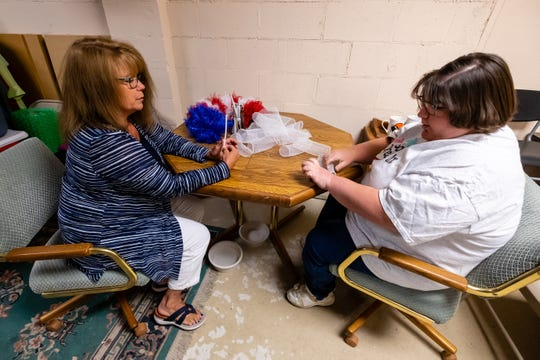 Vicki Helhowski, left, CEO of Soaring Dreams, Inc., helps Courtney Seaford make a wreath Wednesday, June 24, 2020, at Soaring Dreams, Inc., in St. Clair.  The resale shop, which offers volunteer work for people with disabilities, has expanded its services to make T-shirts, hats, mugs and other items.