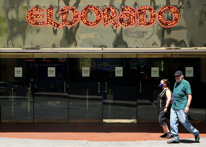 People walk past the entrance to the Eldorado Casino in downtown Reno on June 24, 2020.