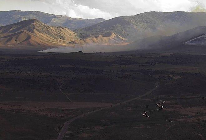 A brush fire burns along U.S. 395 north of Reno on June 23.