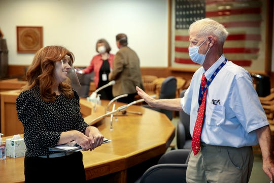 Rep. Christine Drazan, R-Canby, and Senate President Peter Courtney, D-Salem, talk after the Joint Committee on the First Special Session of 2020 took a brief recess at the Oregon State Capitol in Salem.