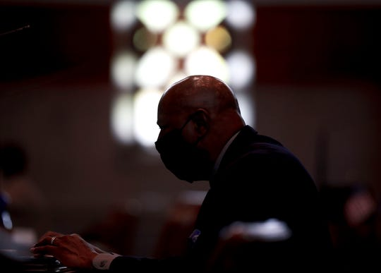 Sen. James Manning Jr.,D-Eugene, makes notes during a special session called to address police reform and coronavirus concerns, at the Oregon State Capitol in Salem, Oregon, on Wednesday, June 24, 2020.