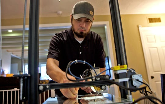 Alan Backlund works with his 3D printers to produce supplies for local hospitals during the covid19 pandemic Tuesday, June 23, 2020.