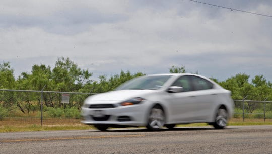 A vehicle travels down a stretch of Christoval Road, seen here in this Tuesday, June 23, 2020 photo, across from Goodfellow Air Force Base that is slated for extensive repairs and enhancements.