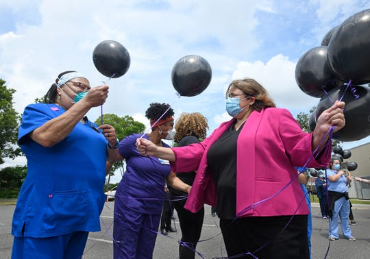 Balloons with the names of Black citizens killed by police are handed out at the CHRISTUS Shreveport-Bossier Health System Prayer Rally for Racial Justice.