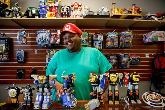 Patrick Wilson, owner of Nrdvana, poses for a portrait with some of the items for sale in his store on Wednesday, June 24, 2020 in Sioux Falls, S.D.