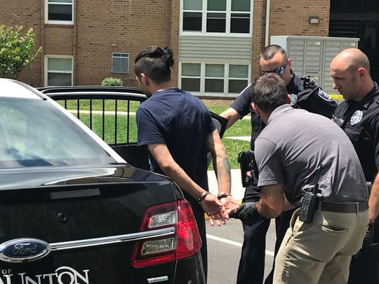 Police arrest Daniel Mead on Wednesday afternoon at the Springhill Village Apartments in Staunton. Mead is charged with murder.