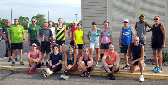 The St. Cloud River Runners pose for a picture before on of their weekly Saturday runs.