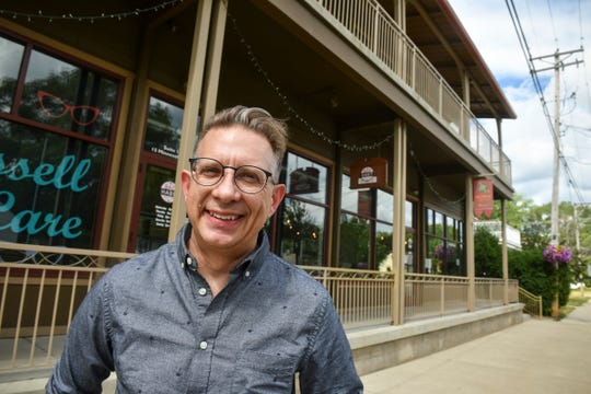 David Boyer stands in front of the planned location for Jupiter Moon Ice Cream Tuesday, June 23, 2020, in St. Joseph. The storefront was the former home of Bad Habit Brewing Co.