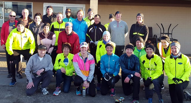 The St. Cloud River Runners pose for a picture before their weekly Saturday run Saturday, March 23, 2019.