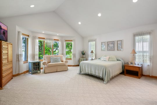 The master bedroom suite is large with vaulted ceilings, a bay window and plenty of room for creating an additional relaxation or sitting area.