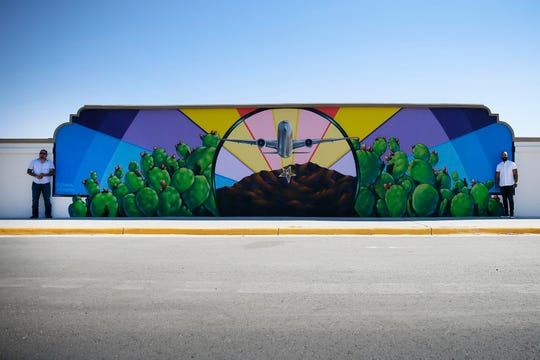 Artists and muralists Jeremiah and Dave Navarro unveil their new mural at El Paso International Airport Wednesday, June 24, in El Paso.