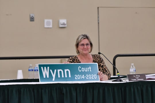 Visalia planning commissioner Liz Wynn holds an honorary street sign recognizing her public service at her final meeting as a commissioner on June 22, 2020.