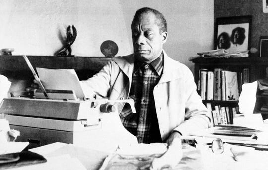 American novelist James Baldwin sits in front of his typewriter in the study of his home in St. Paul de Vence, in southern France, on March 21, 1983.