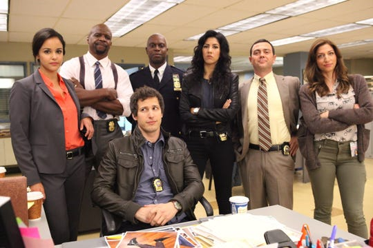 """The cast of """"Brooklyn Nine-Nine"""" will start over on Season 8 after a cast Zoom call featuring Andy Samberg (seated) and (L-R) Melissa Fumero, Terry Crews,  Andre Braugher, Stephanie Beatriz, Joe Lo Truglio and Chelsea Peretti."""