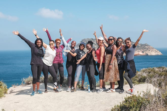 Sienna Brown, fourth from left, and other Black American expatriates go on an outing near Valencia, Spain, in 2018.