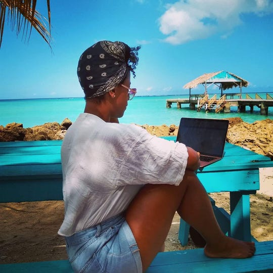 Tiffanie Drayton works on Pigeon Point beach, Trinidad and Tobago, in January.