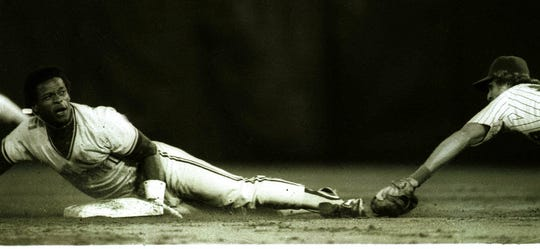 Rickey Henderson holds onto second  base as he slides in with his 119th stolen base of the season on Aug.27,1982 in Milwaukee. The steal  gave him the major league record for stolen bases in a season.