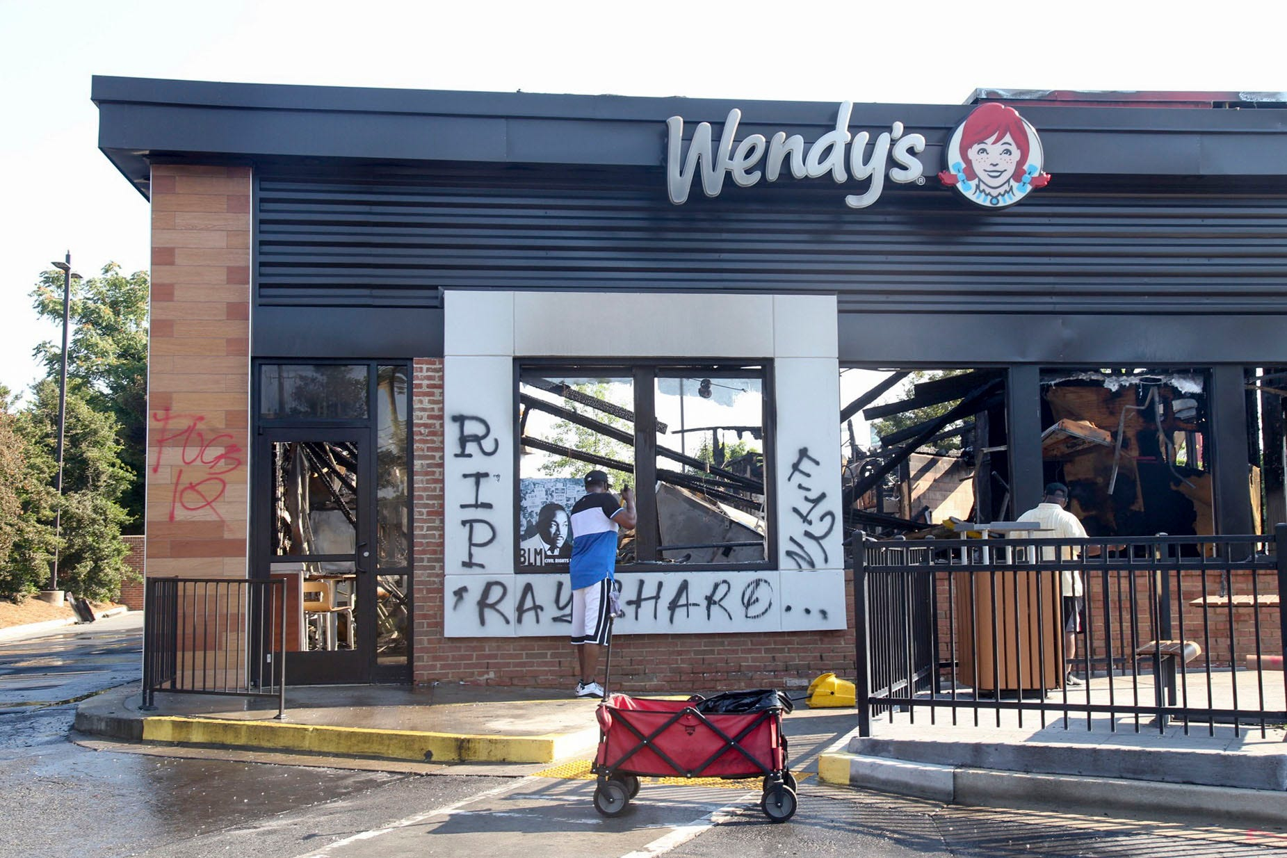 Protest updates: Woman charged in arson of Wendy s; Trump vows order to protect targeted statues; FBI says no hate crime in NASCAR