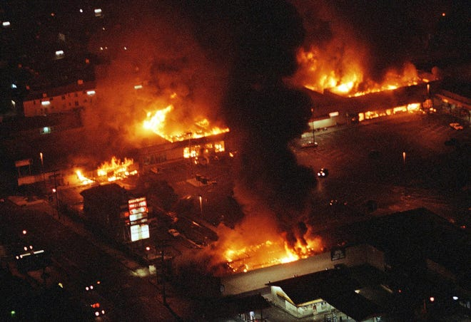 Several buildings are fully engulfed in flames in Los Angeles in April 1992 during the Rodney King trial uprisings.